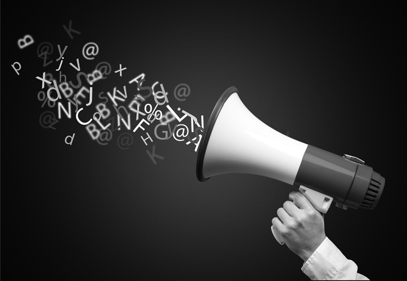 A pr agent holding a megaphone with words floating out of it.