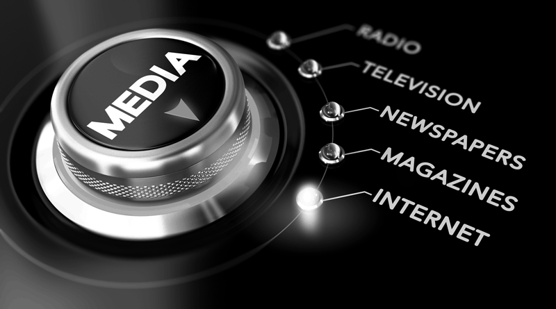 A dial with the word media on it and buttons marked radio, television, news, magazine and internet.